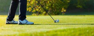 Close-Up of Golfers Feet Addressing Ball on Tee